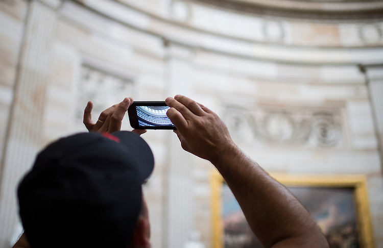 UNITED STATES - JULY 22: A tourist takes photos of the Capitol rotunda on Monday, July 22, 2013. (Photo By Bill Clark/CQ Roll Call)