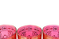 Moroccan tea glasses on a white background