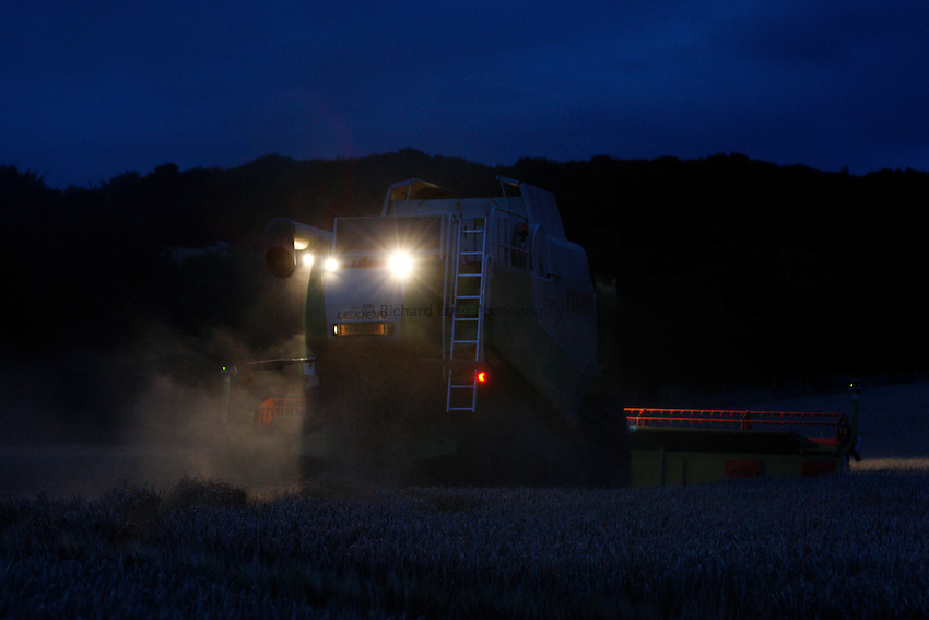 Photo: Richard Lane/Richard Lane Photography. Grain harvest near the Chiltern Hill, Amersham, Buckinghamshire. 16/08/2008. A Class combine harvester cutting spring barley i the dark.