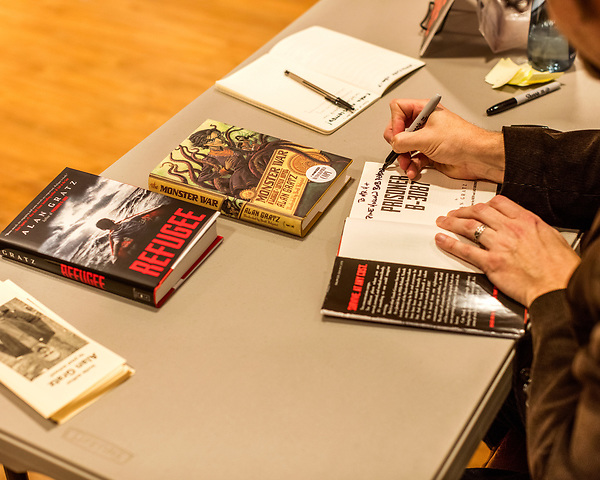 July 26, 2017. Raleigh, North Carolina.<br /> <br /> Alan Gratz signs books after his author's talk. <br /> <br /> Author Alan Gratz spoke about and signed his new book &quot;Refugee&quot; at Quail Ridge Books. The young adult fiction novel contrasts the stories of three refugees from different time periods, a Jewish boy in 1930's Germany , a Cuban girl in 1994 and a Syrian boy in 2015.