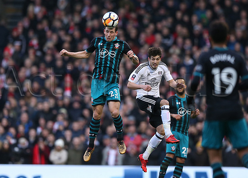 6th January 2018, Craven Cottage, London, England;  FA Cup football, 3rd round, Fulham versus Southampton; Pierre-Emile Hojbjerg of Southampton beats Lucas Piazon of Fulham to head the ball out