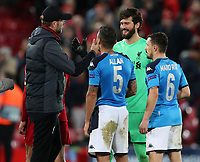 27th November 2019; Anfield, Liverpool, Merseyside, England; UEFA Champions League Football, Liverpool versus SSC Napoli ; Liverpool manager Jurgen Klopp shakes hands with Liverpool goalkeeper Alisson after the final whistle - Editorial Use