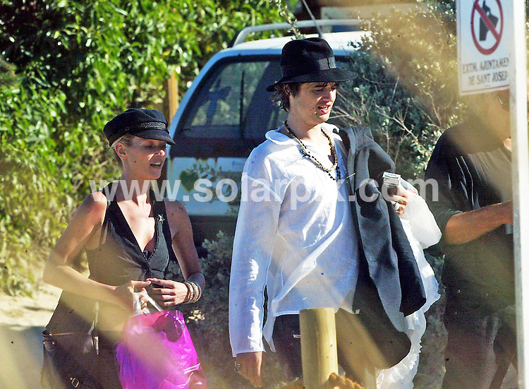 **ALL ROUND EXCLUSIVE  PICTURES FROM SOLARPIX.COM**.**WORLDWIDE SYNDICATION RIGHTS**..These pictures prove that Pete Doherty and Kate Moss are back on again, after their recent row over Pete's difficulty to stay off the drugs..Kate told him to pull his trousers up and get on with it, while on their long weekend break to Ibiza this week. The couple spent the whole day knocking back drinks in a deserted beach bar and later, stopped off at a corner shop to pick up some more provisions in the form of a couple of cans of beer. Maybe he had heard they can refresh the parts other beers cannot reach..JOB REF:  4016    MAD        DATE:  28.05.07.**MUST CREDIT SOLARPIX.COM OR DOUBLE FEE WILL BE CHARGED* *UNDER NO CIRCUMSTANCES IS THIS IMAGE TO BE REPRODUCED FOR ANY ONLINE EDITION WITHOUT PRIOR PERMISSION*