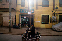 People travel along the streets of the Old City section of Kashgar, Xinjiang, China.