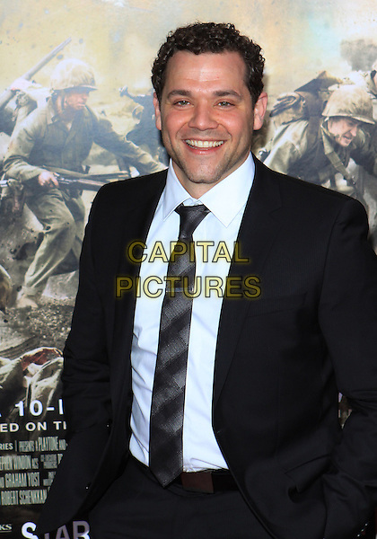 "JOSHUA BITON .Attending the Los Angeles Premiere of HBO's ""The Pacific"" held at Grauman's Chinese Theater, Hollywood, California, USA, 24th February 2010 .half length black suit tie white shirt smiling .CAP/ADM/TC.©T. Conrad/AdMedia/Capital Pictures."