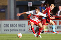 Oliver Risser of Stevenage (On loan from Swindon Town) battles with Mark Duffy of Scunthorpe.  Stevenage v Scunthorpe United - npower League 1 -  Lamex Stadium, Stevenage - 6th October, 2012. © Kevin Coleman 2012