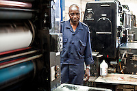 Phares Okoth, operator of Coulorprint's Offset-letterset printer. The machine has made nearly 200 million page prints in its more than 40 years of service.