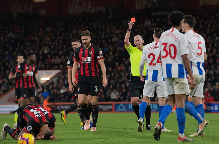 Brighton & Hove Albion's Lewis Dunk is shown a red card by Mike Dean after getting a yellow card for his tackle on Bournemouth's Callum Wilson<br /> <br /> Photographer David Horton/CameraSport<br /> <br /> The Premier League - Bournemouth v Brighton and Hove Albion - Saturday 22nd December 2018 - Vitality Stadium - Bournemouth<br /> <br /> World Copyright © 2018 CameraSport. All rights reserved. 43 Linden Ave. Countesthorpe. Leicester. England. LE8 5PG - Tel: +44 (0) 116 277 4147 - admin@camerasport.com - www.camerasport.com