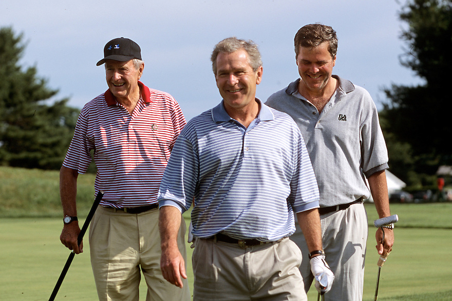 Former United States President George H.W. Bush  walks with sons President George W. Bush and Florida Governor Jeb Bush as they leave the 18th green after playing an early morning round at Cape Arundel Golf Club in Kennebunkport, Maine.