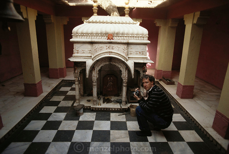 Hindu Rat Temple in Deshnoke, Rajasthan, India. This ornate Hindu temple was constructed by Maharaja Ganga Singh in the early 1900s as a tribute to the rat goddess, Karni Mata.; Peter Menzel photographing at the original rat temple, now incorporated into the large complex..