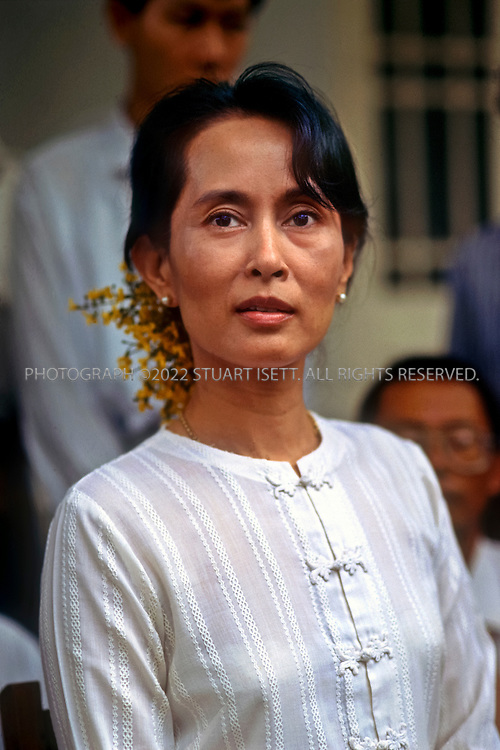 7/13/1995--RANGOON, BURMA Yangon, Myanmar Burmese democracy leader AUng San Suu Kyi speaking to reporters in the garden of her Rangoon home. ©2010 Stuart Isett. All rights reserved.
