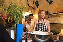 New Zealand twins Harry and Carter Were prepare breakfast at Ristorante Marta, Milan April 12, 2016. In the foreground a blue vase by designer Phil Cuttance. At this restaurant for Salone del mobile 2016, Airbnb have organized Makers &amp; Bakers, an experiential installation curated by creative director Ambra Medda, where the press meet young design talents. &copy; Carlo Cerchioli<br /> <br /> Le gemelle Harry e Carter Were preparano la colazione al ristorante Marta, Milano 12 aprile, 2016. In primo piano un vaso del designer Phil Cuttance. In questo ristorante per il Salone del mobile 2016, Airbnb ha organizzato Makers &amp; Bakers una installazione esperienziale curata da Ambra Medda dove la stampa incontra alcuni giovani talenti del design internazionale.