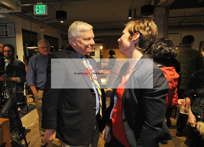 U.S. Congressional candidate Steve Lindbeck, left, shares a moment with state house candidate Ivy Spohnholz Tuesday, November 8, 2016 in Anchorage, Alaska.  (AP Photo/Michael DInneen)