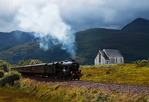 A pictorial of the famous Harry Potter Hogswart Express steam train, The Jacobite, passing by an abandoned church in the highlands on its way from Ft. William to Mallaig, Scotland.