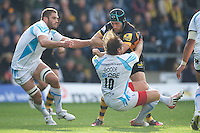 Chris Bell of London Wasps drives his way through Andy Goode of Worcester Warriors during the Aviva Premiership match between London Wasps and Worcester Warriors at Adams Park on Sunday 7th October 2012 (Photo by Rob Munro)