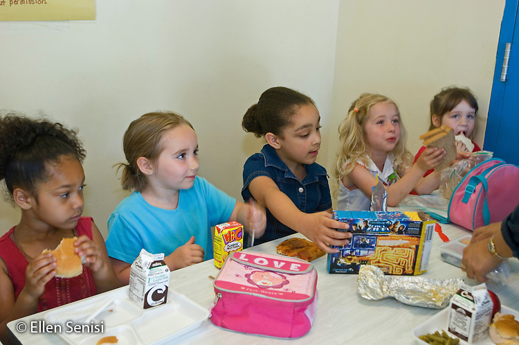 Schenectady, NY.Zoller School (urban public elementary school).Girls (aged 5) at table in school lunch room..MR: AF-gKb.© Ellen B. Senisi
