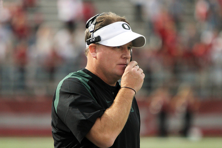 Oregon head football coach, Chip Kelly, communicates with his staff in the booth during the Ducks Pac-10 conference game against the Washington State Cougars at Martin Stadium in Pullman, Washington, on October 9, 2010.  In a game that went back and forth early in to the fourth quarter, Oregon finally prevailed over the Cougars, 43-23.