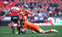 Nicolas Sanchez and Javier Ortega Desio of the Jaguares tackling Warren Whiteley (captain) of the Emirates Lions during the Super Rugby quarter-final match between the Emirates Lions and the Jaguares at the Emirates Airlines Park Stadium,Johannesburg, South Africa on Saturday, 21 July 2018. Photo: Steve Haag / stevehaagsports.com