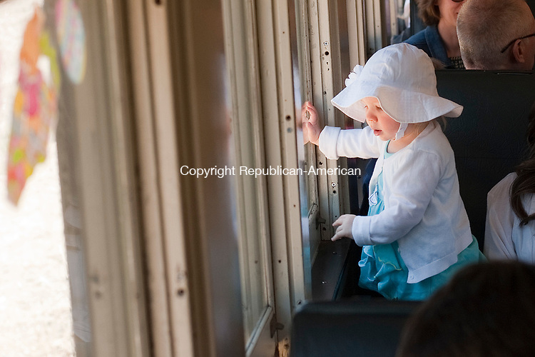 THOMASTON, CT-040917JS05-Paisley Costello, 1, of Watetown, looks out the window as the train passes through Thomaston Dam during the Naugatuck Railroad's Easter Bunny Express ride from the Thomaston station on Sunday. The event will also be held Saturday, April 15  with rides at 11 a.m., 1 and 3 p.m. <br /> Jim Shannon Republican-American