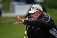 Miguel Angel Jimenez asks the crowd to stand still as he lines up his putt on the 15th green during Round1 of the 3 Irish Open on 16th May 2009 (Photo by Eoin Clarke/GOLFFILE)