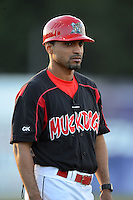 Batavia Muckdogs manager Angel Espada (4) during a game against the Aberdeen Ironbirds on August 9, 2013 at Dwyer Stadium in Batavia, New York.  Aberdeen defeated Batavia 8-5  (Mike Janes/Four Seam Images)