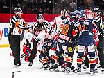 Stockholm 2013-12-28 Ishockey Hockeyallsvenskan Djurg&aring;rdens IF - Almtuna IS :  <br /> Almtuna Marcus H&ouml;gstr&ouml;m i slagsm&aring;l med en Djurg&aring;rden spelare medan domare Niclas Johansson och domare Johan Nordl&ouml;f f&ouml;rs&ouml;ker avstyra br&aring;ket<br /> (Foto: Kenta J&ouml;nsson) Nyckelord:  slagsm&aring;l br&aring;k fight fajt gruff