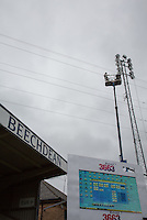 General view of the Floodlights being worked on at Wycombe Wanderers Stadium, Adams Park, High Wycombe, Bucks, England on 12 July 2015. Photo by Andy Rowland.