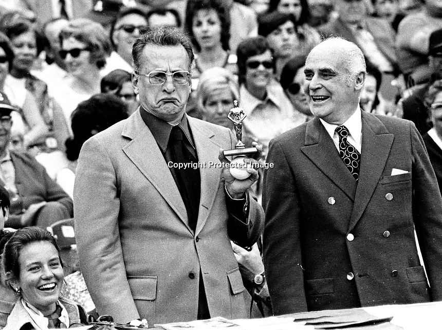Actor George C. Scott accepts a toy Oscar from A's owner Charlie Finley prior to the A's American League playoff game against the Tigers wife Trish Van Devere on his left.. (1972 photo/Ron Riesterer)