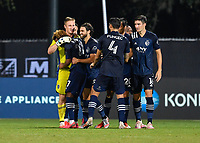 LAKE BUENA VISTA, FL - JULY 26: Tim Melia of Sporting KC embraces Gianluca Busio of Sporting KC following the shootout during a game between Vancouver Whitecaps and Sporting Kansas City at ESPN Wide World of Sports on July 26, 2020 in Lake Buena Vista, Florida.