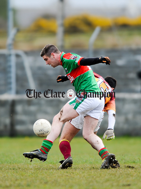 Darren Hickey of Kilmurry Ibrickane in action against XXXX of St Joseph's Miltown Malbay during their Cusack Cup game in  Miltown Malbay. Photograph by John Kelly.