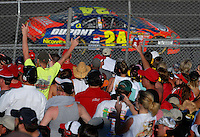 Apr 29, 2007; Talladega, AL, USA; Fans react after Nascar Nextel Cup Series driver Jeff Gordon (24) took the checkered flag under caution to win the Aarons 499 at Talladega Superspeedway. Mandatory Credit: Mark J. Rebilas
