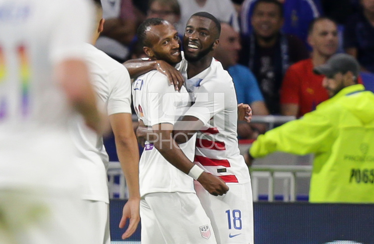 Lyon, France - Saturday June 09, 2018: Julian Green scores and celebrates with his U.S. Men's team mates during an international friendly match between the men's national teams of the United States (USA) and France (FRA) at Groupama Stadium.