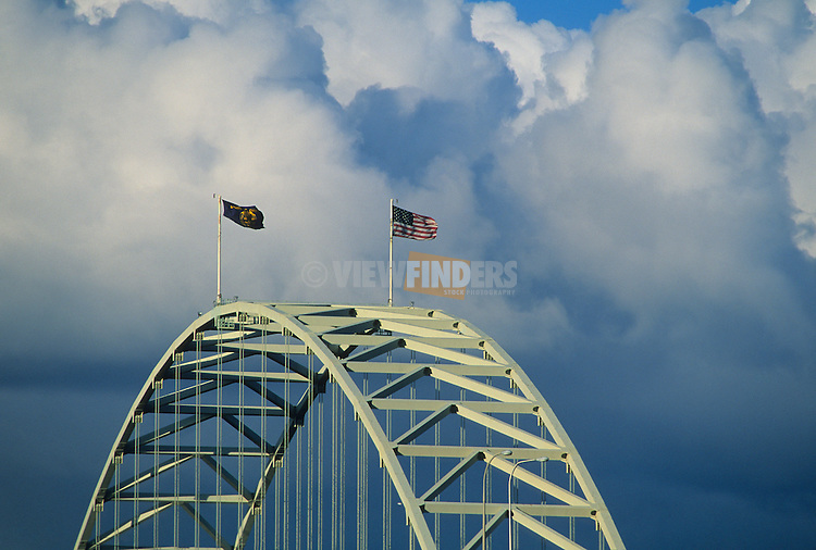 Fremont Bridge Arch with Flying Flags on a Cloudy Day
