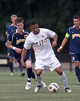 Boston College forward Charlie Rugg (17) controls the ball as Quinnipiac University midfielder Tim Quigley (13) closes. Boston College defeated Quinnipiac, 5-0, at Newton Soccer Field, September 1, 2011.