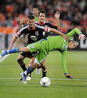 D.C. United midfielder Nick DeLeon (18) tackles Seattle Sounders midfielder Osvalo Alonso (6) D.C. United tied the Seattle Sounders, 0-0 at RFK Stadium, Saturday April 7, 2012.