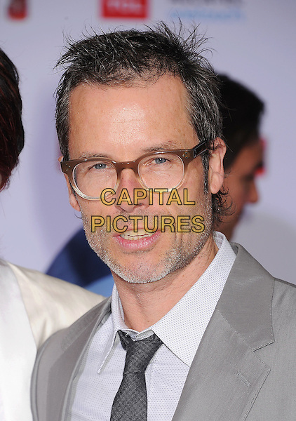 "Guy Pearce.arriving at the Los Angeles Premiere of ""Iron Man 3"" at El Capitan Theatre in Hollywood, California, USA, .April 24, 2013. .portrait headshot glasses grey gray suit tie white shirt beard facial hair .CAP/ROT/TM.©TM/Roth Stock/Capital Pictures"