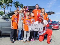 January 3, 2014 - Miami Gardens, Florida, U.S: Super Fan Larry Buckeyeman Lokai poses with Clemson fans for a picture before the Discover Orange Bowl game between the Clemson Tigers and the Ohio State Buckeyes at Sun Life Stadium in Miami Gardens, Fl