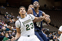 January 14, 2012:   Jacksonville Dolphins guard Tevin Galvin (23) and East Tennessee State Buccaneers forward Isiah Brown (41) fight for rebound position during Atlantic Sun conference action between the Jacksonville University Dolphins and East Tennessee State University Buccaneers at Veterans Memorial Arena in Jacksonville, Florida.   East Tennessee State defeated Jacksonville 72-58.