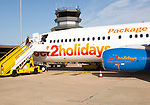 Jet2 package holiday plane passengers disembarking at the airport Faro, Algarve, Portugal