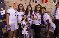 PASADENA, CA - AUGUST 4: Lindsey Horan #9 and Crystal Dunn #19 pose with the family of Gianni Infantino during a game between Ireland and USWNT at Rose Bowl on August 3, 2019 in Pasadena, California.