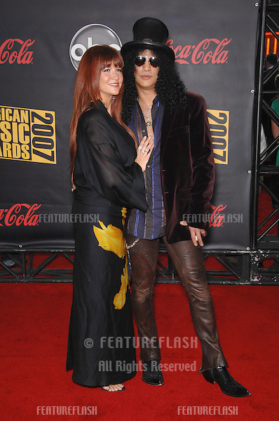 Slash & Perla Ferrar at the 2007 American Music Awards at the Nokia Theatre, Los Angeles..November 19, 2007  Los Angeles, CA.Picture: Paul Smith / Featureflash