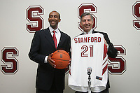 STANFORD, CA - APRIL 28:  Stanford Cardinal men's basketball head coach Johnny Dawkins (L) is introduced by director of athletics Bob Bowlsby (R) during a press conference on April 28, 2008 at Kissick Auditorium in Stanford, California. (Photo by David Gonzales/Stanford via Getty Images)