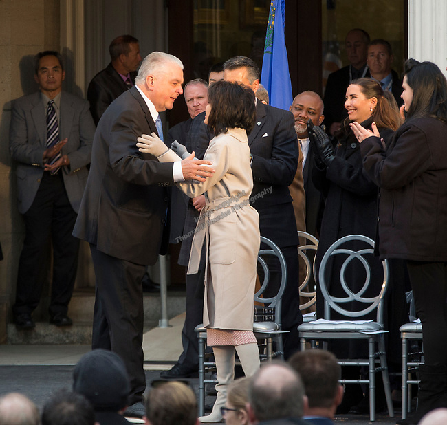 Governor-elect Steve Sisolak is sworn into office on the steps of the Nevada State Capitol in Carson City, Nev., Monday, Jan. 7, 2019. (AP Photo/Tom R. Smedes)
