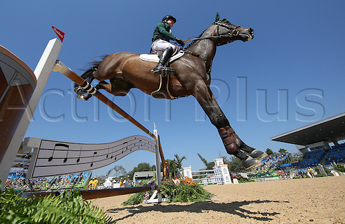14.08.2016. Rio de Janeiro, Brazil. Greg Patrick Broderick of Ireland on horse Going Global clears an obstacle during the Jumping Individual 1st Qualifier of the Equestrian competition at the Olympic Equestrian Centre during the Rio 2016 Olympic Games in Rio de Janeiro, Brazil, 14 August 2016.
