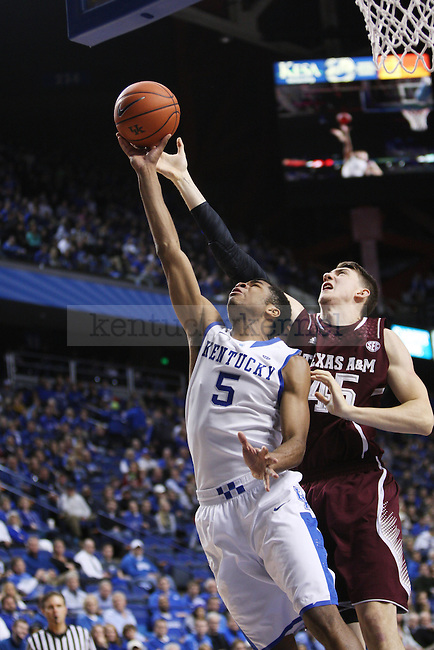 Kentucky Wildcats guard Andrew Harrison (5) takes the rebounds the ball from Texas A&M center Dylan Johns (45) during the second half of UK Men's Basketball vs. Texas A&M at Rupp Arena in Lexington, Ky., on Tuesday, January 21, 2014. UK defeated Texas A&M 68-51. Photo by Emily Wuetcher | Staff
