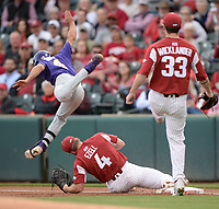 NWA Democrat-Gazette/ANDY SHUPE<br /> Arkansas first baseman Trevor Ezell (4) stretches to keep his foot on the bag Friday, May 10, 2019, as LSU shortstop Josh Smith leaps to avoid him during the first inning at Baum-Walker Stadium in Fayetteville. Visit nwadg.com/photos to see more photographs from the game.