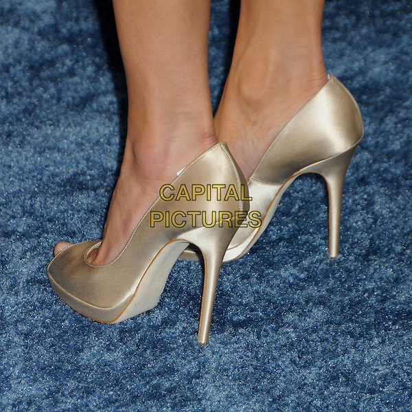 MARIA BELLO's shoes .25th Annual Film Independent Spirit Awards - Arrivals held at the Nokia Event Deck at L.A. Live, Los Angeles, California, USA..March 5th, 2010.feet heels gold nude beige cream peep toe shoes .CAP/ADM/BP.©Byron Purvis/AdMedia/Capital Pictures.