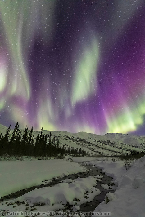 Northern lights over the Brooks Range mountains in Alaska's Arctic.