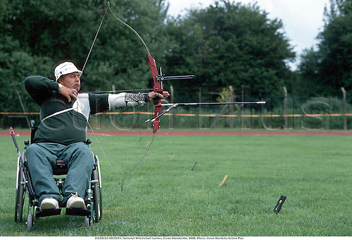 DISABLED ARCHERY, National Wheelchair Games, Stoke Mandeville, 9406. Photo: Steve Bardens/Action Plus...1994.handicapped.disabled sport.wheelchair wheelchairs.archery.arrow arrows.bow