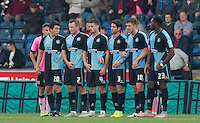 Wycombe players line up a wall as Northampton score through a free kick during the Sky Bet League 2 match between Wycombe Wanderers and Northampton Town at Adams Park, High Wycombe, England on 3 October 2015. Photo by Andy Rowland.